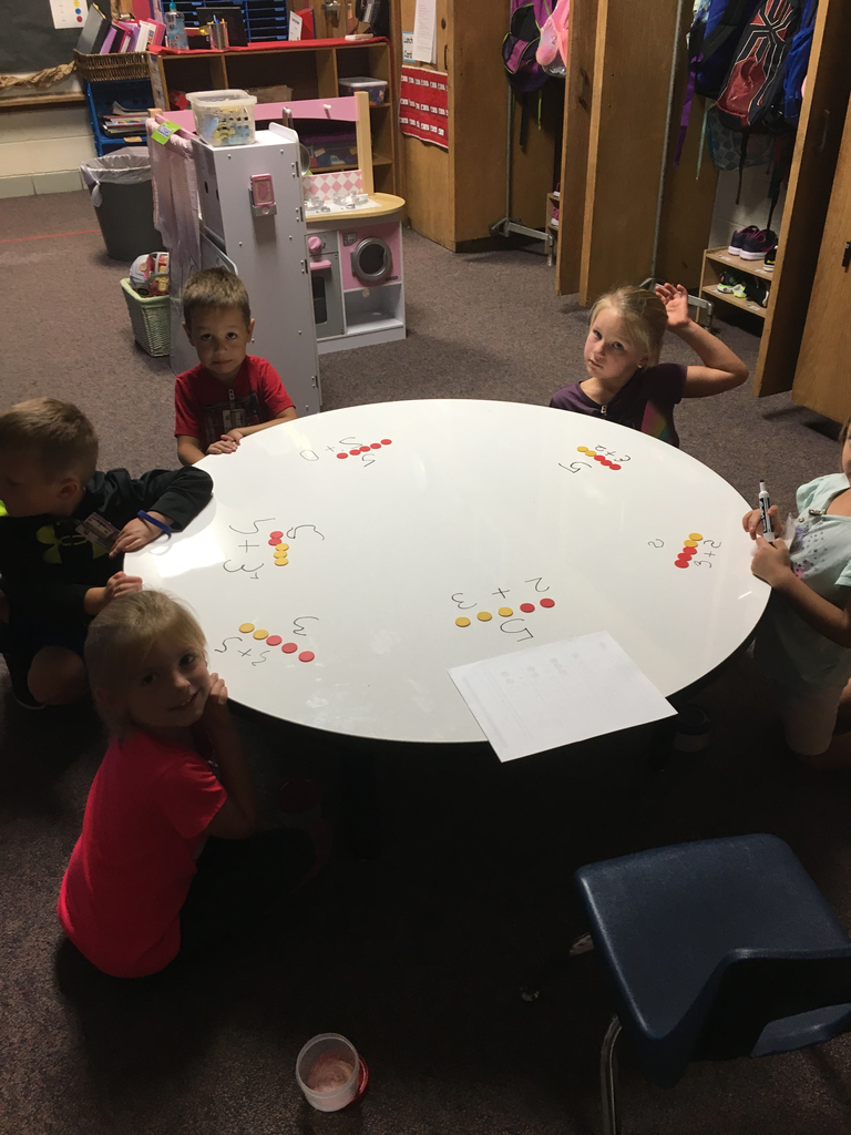 "Mrs. Hoffman's class worked on some ""hidden partners"" (small numbers hiding in bigger numbers) at math! We even used our dry erase table!!"